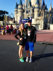 At Magic Kingdom with our Wine and Dine Half Marathon metals!
